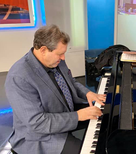 Bruce Barth playing piano in a television studio.