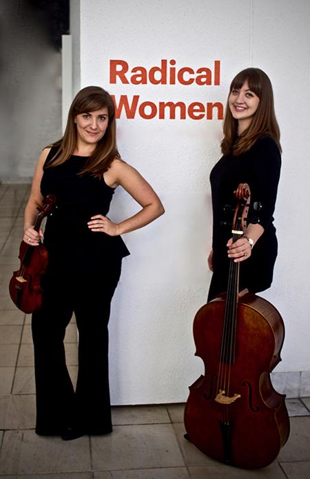 Photo: Lindsey Strand-Polyak, baroque violin, and Alexa Haynes-Pilon, baroque cello of Ensemble Bizarria pose for the camera.