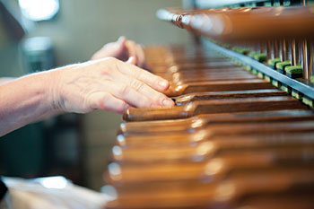 close up of carillonneur hands playing instrument