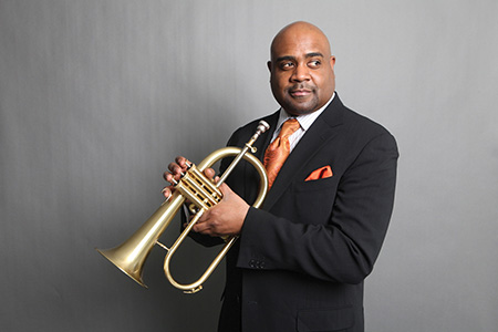 posed photo of Terell Stafford holding trumpet