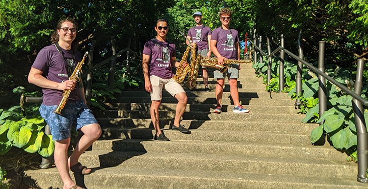 Photo on the stairs of Beall Botanical Garden, members of Group 2: Evan Harris, Eric Zheng, Adam Epler, Tyler Young. This event was recorded following safety guidelines and regulations set by Michigan State University and the State of Michigan.
