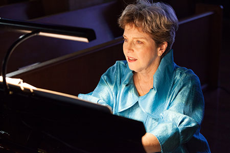 Photo: Mary Dibbern, seated at piano. She is a internationally recognized coach, collaborative pianist, editor and author.