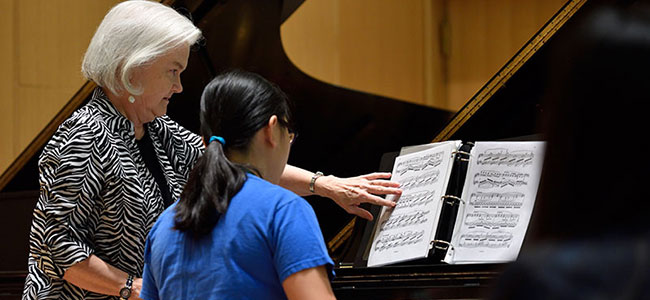 Deborah Moriarty works with Joey Tan during a master class. image