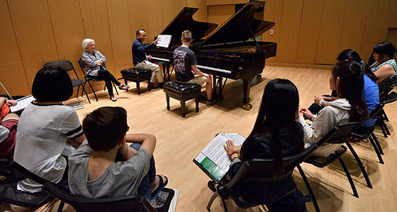 2017 Celebrating the Spectrum participants observe Derek Polischuk as he works with Kalil Olsen in a master class image