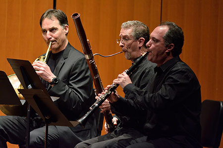 Performing on the stage of Fairchild Theatre, Corbin Wagner, horn; Michael Kroth, bassoon; Guy Yehuda, clarinet