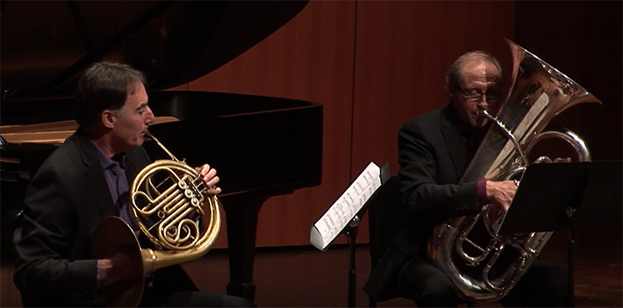 Photo: Corbin Wagner, horn and Phil Sinder, tuba perform on stage at the Fairchild Theatre