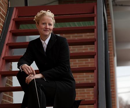 Katherine Kilburn sitting on steps, outdoors.
