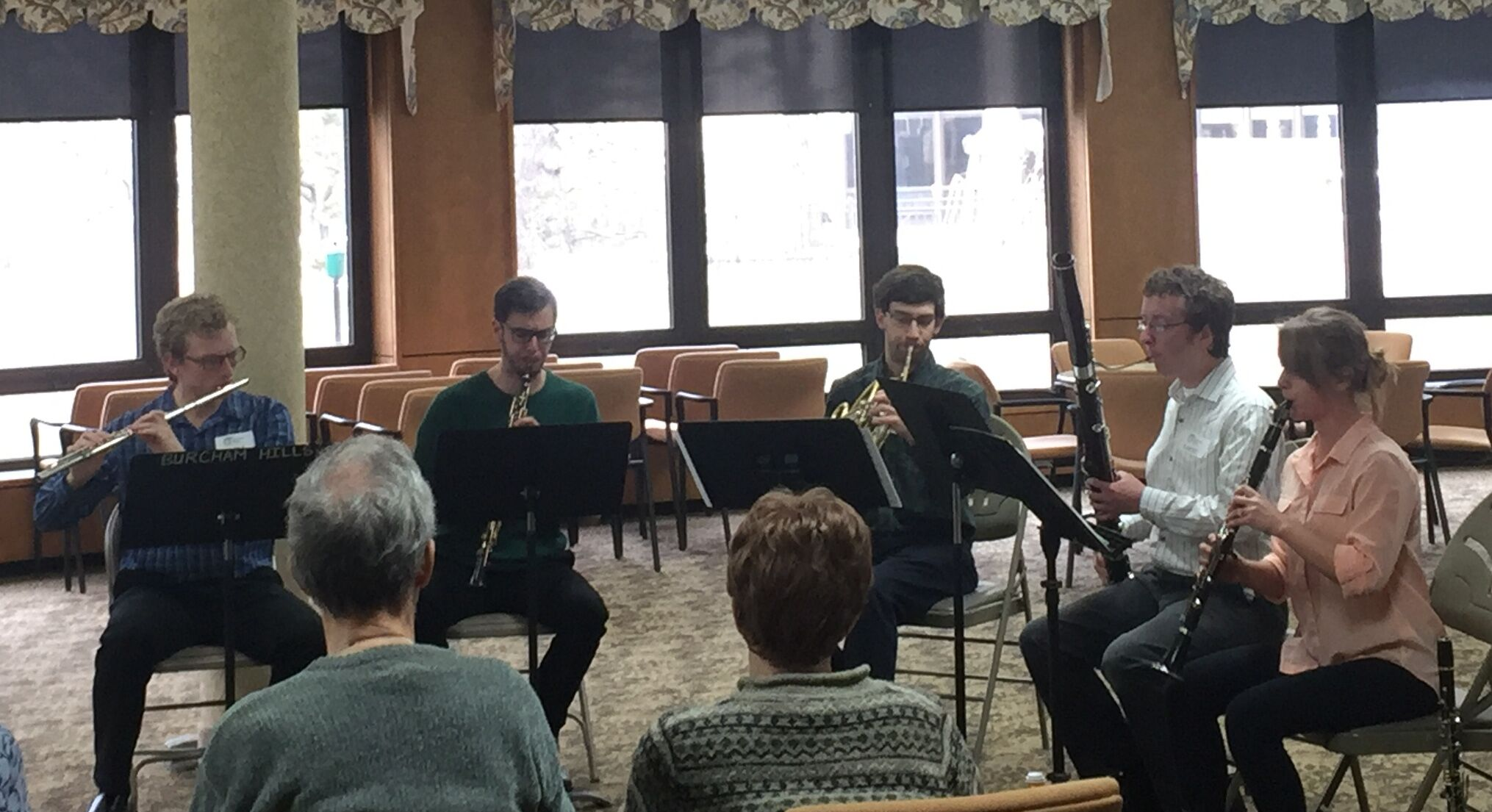 Members of the Verdant Winds woodwind quintet perform for Burcham Hills residents. image