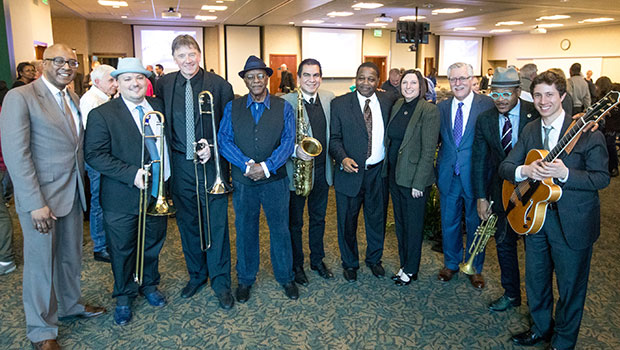 The MSU Professors of Jazz pose with Conrad Herwig and others at the MSUFCU Blue Mondays concert. image