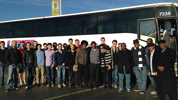 MSU jazz professors Randy Gelispie and Rodney Whitaker, pose with Christian McBride and students outside a tour bus. image