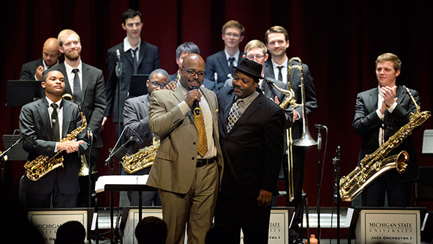 Christian McBride and Rodney Whitaker acknowledge the week's residency on stage with MSU Jazz Orchestra.  image