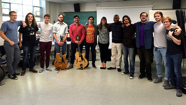Russell Malone pauses for a group photo after a workshop with the MSU Jazz Guitar Studio. image