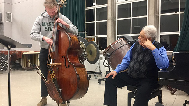 Rufus Reid works with MSU Jazz Studies graduate student Louis Leager. image