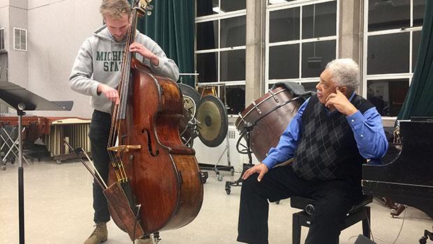 Rufus Reid works with MSU Jazz Studies graduate student Louis Leager. image