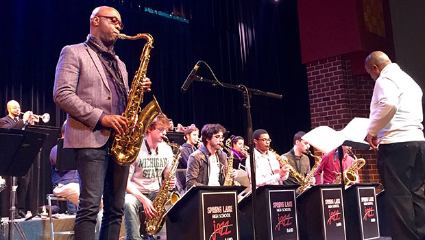 Tim Warfield, Jr. and Director of Jazz Studies Rodney Whitaker work and perform with students at Spring Lake High School. image