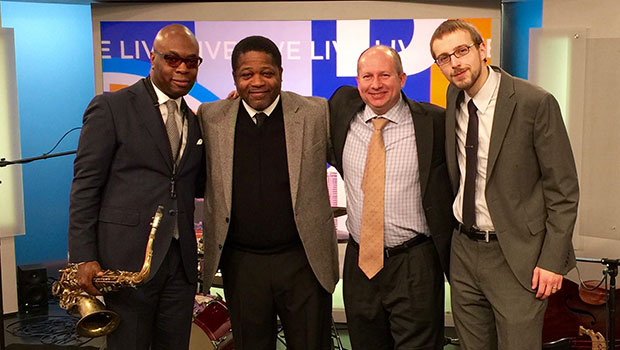 Tim Warfield, Jr. and Director of Jazz Studies Rodney Whitaker pose with Max Colley III and Corey Kendrick at WDIV studios in Detroit. image