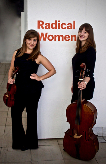 Photo: Lindsey Strand-Polyak, baroque violin, and Alexa Haynes-Pilon, baroque cello pose for the camera.